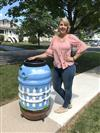 Jenny Babyar and painted rain barrel for raffle